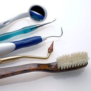 a toothbrush, dental picks, and a mouth mirror